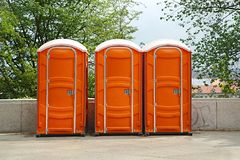 Portable Toilets on an Event. Row of mobile toilets in an urban area stock image