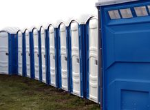Portable Toilets. A long line of portable toilets at the fair royalty free stock photography