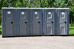 Portable Toilets. In a park setting with no people Royalty Free Stock Images