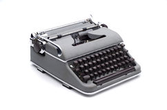 Portable typewriter. Old grey portable typewriter on white background Royalty Free Stock Image