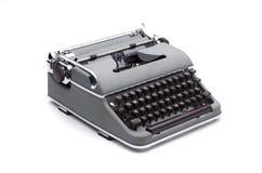 Portable typewriter. Old grey portable typewriter on white background royalty free stock image