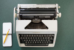 Portable typewriter, circa 1970, with notepad Royalty Free Stock Photo