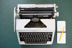 Portable typewriter, circa 1970, with notepad Royalty Free Stock Photography