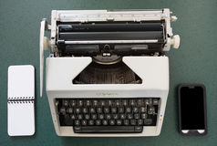 Portable typewriter, circa 1970, with notepad Royalty Free Stock Images
