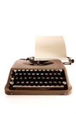 Portable typewriter and paper. Conic typewriter from bestselling novel stock photos