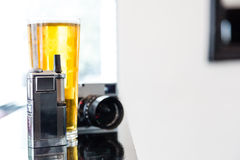 Portable vaporizer, digital camera and beer Stock Images