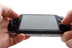 Portable video game in hand Royalty Free Stock Images