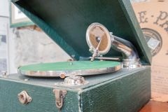 Portable vinyl record player in green suitcase royalty free stock images