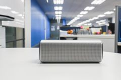 Portable wireless loud speaker in office for listening to music Stock Images