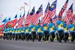 Portador de bandeira de Malásia durante o Dia da Independência de Malásia Fotografia de Stock Royalty Free
