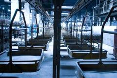 Portadores en una planta de fabricación Fotografía de archivo libre de regalías