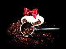 Portafilter brown beans bow whitecup. White black espresso coffee cafe caffeine Stock Image