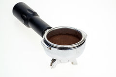 Portafilter from an Espresso Machine. Espresso coffee portafilter with ground coffee power within Royalty Free Stock Photography