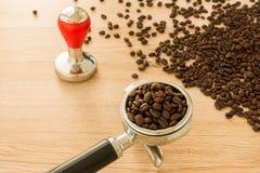 Portafilter, Espresso Tamper and Coffee Beans Stock Photos