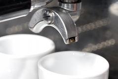 Portafilter Fixed into Coffee Machine. Stock Photo