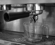 Portafilter on top of espresso machine, coffee shop Royalty Free Stock Photography