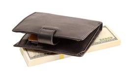 Portafoglio con i dollari e una carta assegni Fotografia Stock