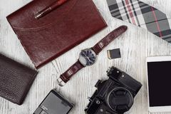 Portafoglio della macchina fotografica della foto dell'azionamento dell'istantaneo del legame del telefono cellulare dell'orologi Fotografie Stock