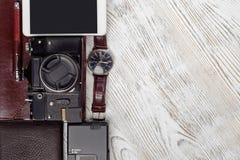 Portafoglio della macchina fotografica della foto dell'azionamento dell'istantaneo del legame del telefono cellulare dell'orologi Fotografie Stock Libere da Diritti