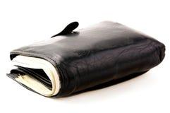 portafoglio nero con le banconote su fondo leggero Fotografia Stock
