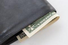 Portafoglio nero di cuoio con una banconota del dollaro fotografia stock