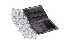 Portafoglio nero in pieno di soldi Fotografie Stock