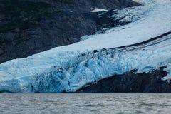 Portage glacier in deep shadow of mountain in summer Alaska Royalty Free Stock Photography