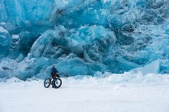 Portage glacier in wintertime. Biker admire the awesome view of the  Portage glacier, Alaska, USA Stock Photography