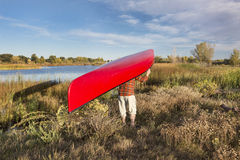 Portaging canoe Stock Photo