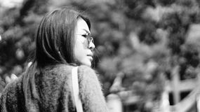Portait of Asian woman looking to the right with blur bokeh background Royalty Free Stock Photography