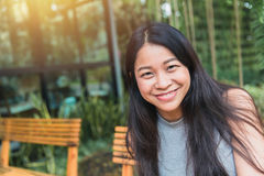 Portait Asian women black long hair adult happy smile. Portait Asian woman black long hair adult happy smile enjoy in the garden cafe with space for text Stock Photo