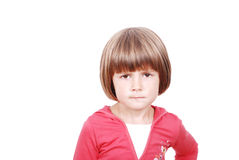 Portait of beautiful serious little girl. Isolated in white Royalty Free Stock Images