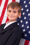 Portait of Caucasian boy with American flag Royalty Free Stock Image