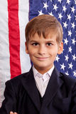 Portait of Caucasian boy with American flag Stock Photography
