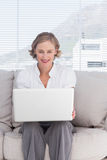 Portait of cheerful businesswoman with a laptop Stock Image