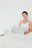 Portait of a dark-haired woman using a laptop Stock Photo
