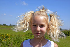 Portait of a Dutch blonde girl. Portrait of a Dutch blonde young girl with funny hair royalty free stock photography