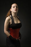 Portait of a gothic girl. Gothic girl with long brown hair posing on black background Royalty Free Stock Photo