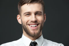 Portait of handsome young businessman smiling with positivity. Stock Photography