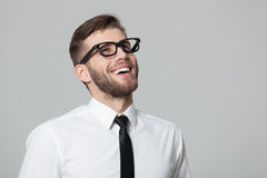 Portait of handsome young businessman smiling with positivity. Royalty Free Stock Image