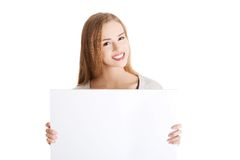 Portait of happy woman holding an empty baner Stock Image