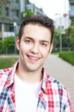 Portait of a laughing student with checked shirt Stock Photos
