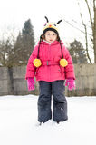 Portait of a little girl in winter clothes having fun in the sno Stock Photo