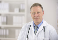 Portait of a mature doctor Stock Photos