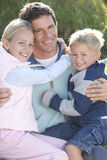 Portait of mid adult man with son and daughter. Portait of mid adult men with son and daughter royalty free stock photos