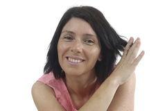 Portait of a middle aged woman on white. Background Royalty Free Stock Photography