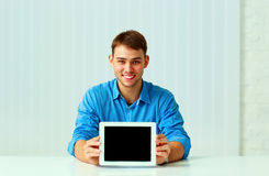 Portait Of A Young Businessman Shows The Tablet Computer Display Royalty Free Stock Images