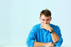 Portait Of A Young Laughing Businessman In Blue Shirt Stock Photo