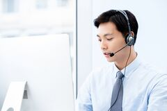 Free Portait Of Young Handsome Male Asian Call Center Agent Royalty Free Stock Images - 180777939