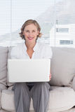 Portait of a smiling businesswoman using a laptop Stock Photo
